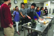 Students prepare a meal in culinary arts.