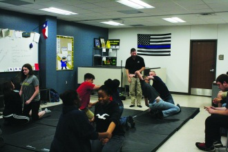 Students practice taking down subjects in the law enforcement class.