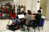 A string quartet of orchestra members performs in the cafeteria